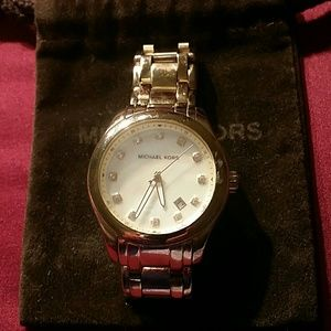 Authentic Michael Kors gold watch.